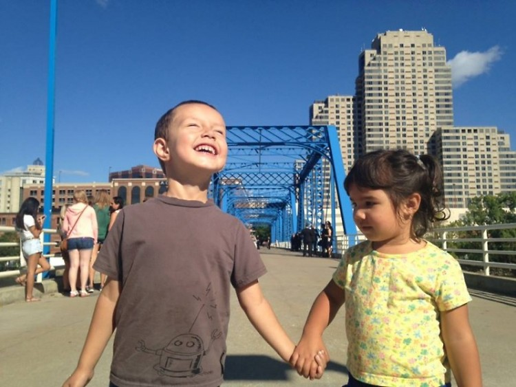 Maddie Steele and Ani Bechiri play together on the Blue Bridge- substitute for their mothers, who prefer to be behind the scenes