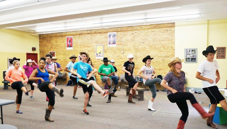 """Students run through a """"Footloose"""" dance number."""
