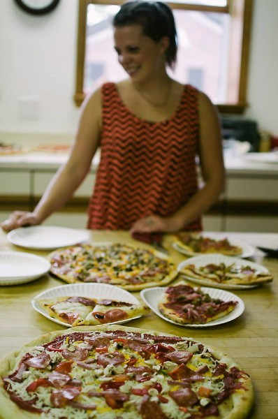 A previous Love Feast included pizzas cumulatively made from single ingredients brought by guests.