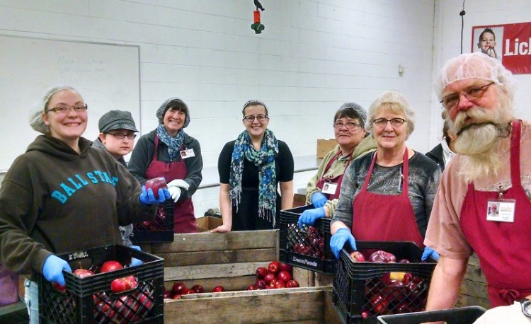 Maggie Marcinkus, center, with a group of volunteers at Feeding America West Michigan.