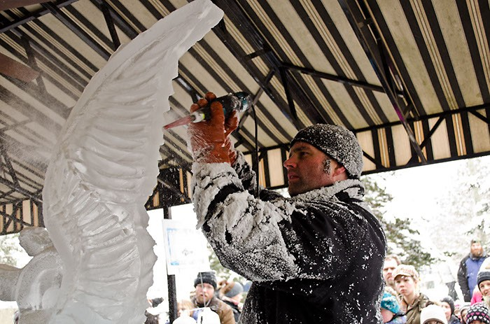 Derek Maxfield, co-owner of Grand Rapids' Ice Sculptures Ltd., getting frosty during Rockford Ice Festival 2012.
