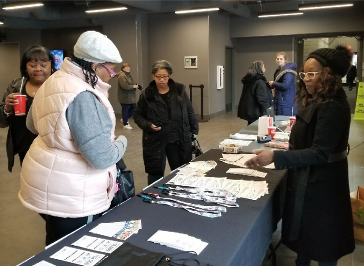 Grand Rapids census ambassadors answering questions about the 2020 census at Celebration Cinema Studio Park on January 20, 2020