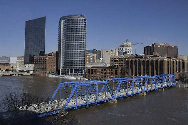 Blue skies and sun shine Monday as the Grand River receded from near record flooding over the weekend