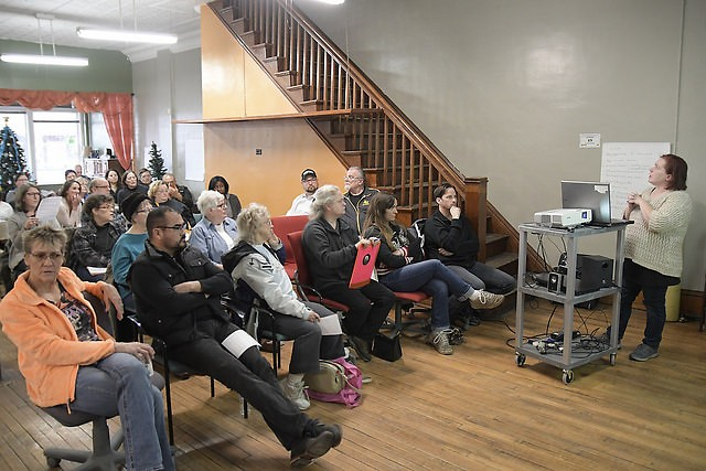 Chi Benedict informs residents of the purposed zoning changes during a meeting held at  the West Grand Neighborhood Organization