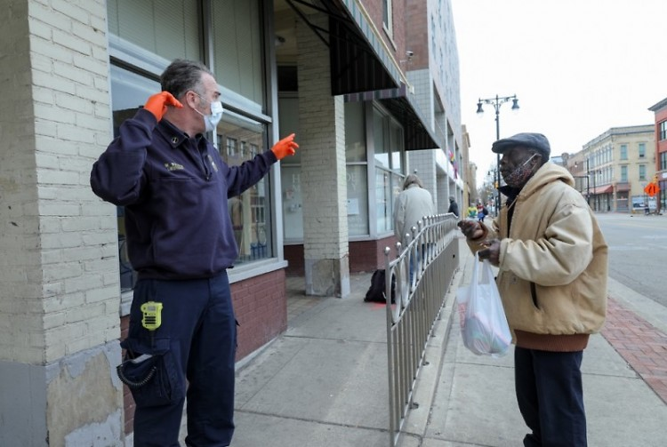 Fire Capt. Mike Waldron, HOT member, talking with a pedestrian on Division Ave. S.