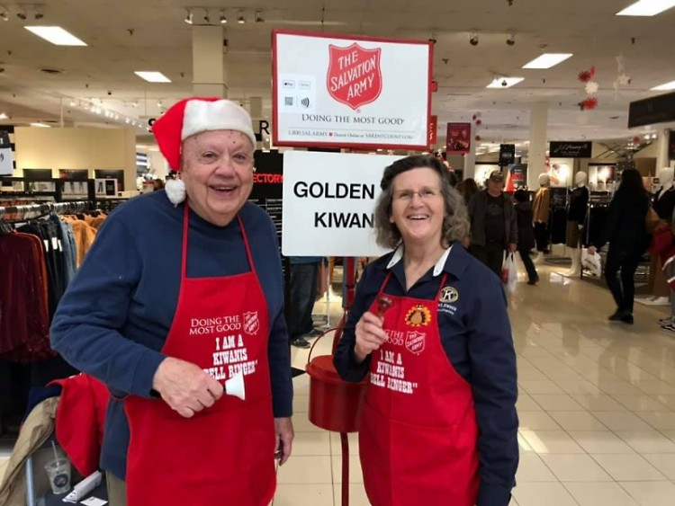 "Judd Ross and Club President Gloria Canglegosi from the Golden ""K"" Kiwanis Club ring bells at Woodland Mall on Black Friday."