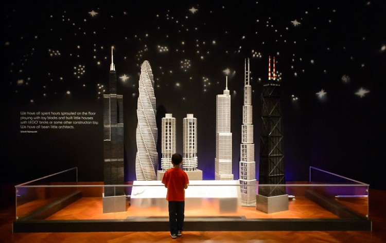 A child marvels at Tucker's architectural creations at a previous museum exhibit.