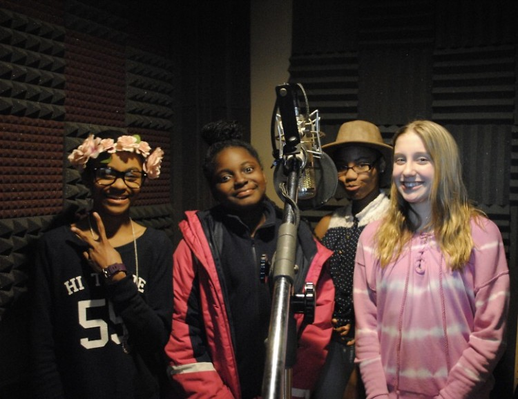 CYC and Triumph students prepare to record for the spoken word and music album.
