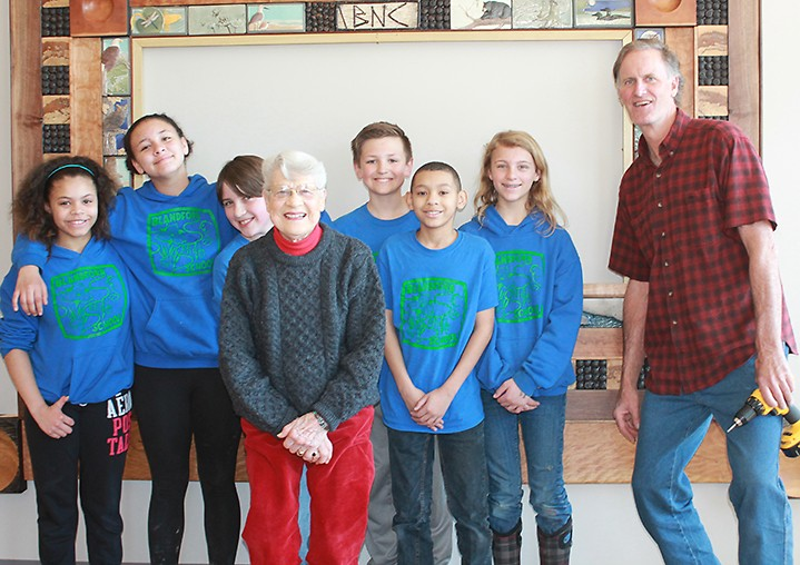 Mary Jane Dockeray and students from nearby Blandford School helped install the donor wall with Jeff Lende, an artist and former