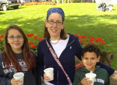 Alyssa Morillo Scheidt and her children at the apple orchard