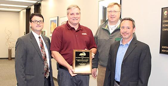 James Hurt (City of GR), Jack Freyling (Franklin Holwerda), Greg Krcmarik (City of GR), and John Hayes (City of GR) accept award