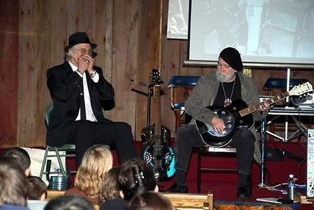 """Jimmie Stagger and David """"Dr. Hamfat"""" Marin performing live blues for students"""