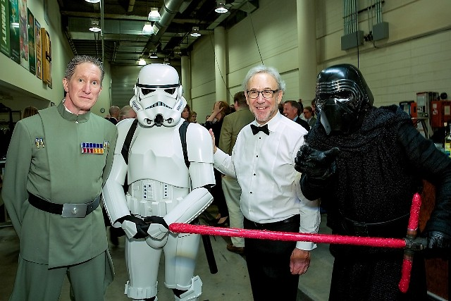 Bob Bernhardt, principal pops conductor of the Grand Rapids Symphony, with characters from 'Star Wars.'