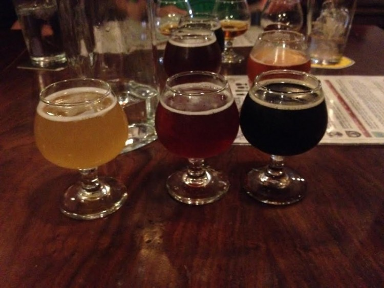 Sampling flights at Brewery Vivant as part of my work for The Rapidian