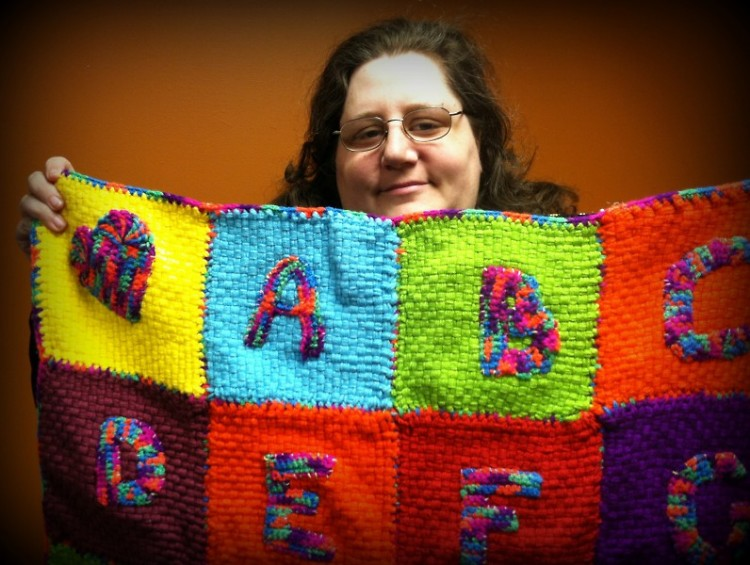 Candace with a handmade baby quilt