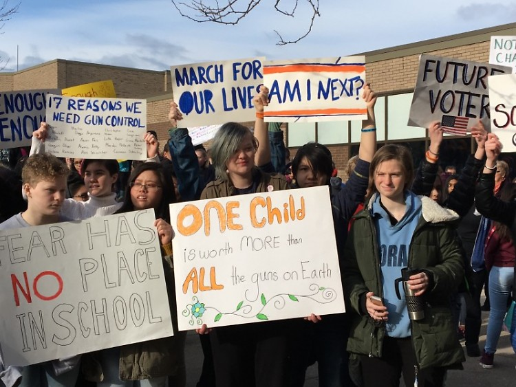 City students hold signs for school safety