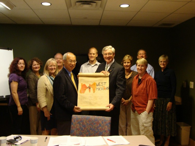 Members of the Community Literacy Initiative advisory council sign the Right to Literacy Scroll.