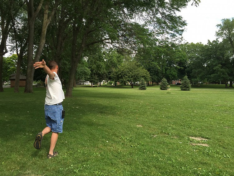 Rick Marritt flings a disc toward a basket at Riverside Park's course