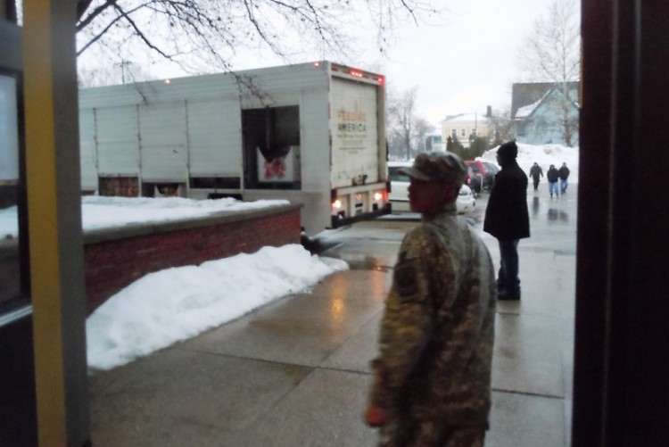 A cadet in Innovation Central High School's JROTC program waits for the Food Bank's Mobile Food Pantry to arrive.