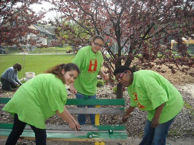 Volunteers painting park benches