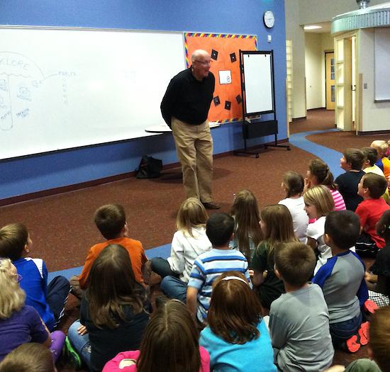 Ed Boer tells fables to elementary children