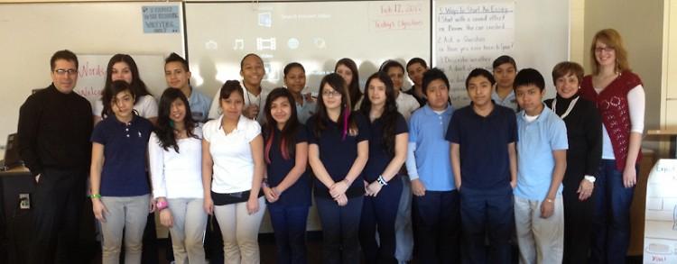 Alex Escamilla (left) with his class, Principal Carmen Fernandez, and Rapidian Community Engagement Specialist Chelsea LaForge