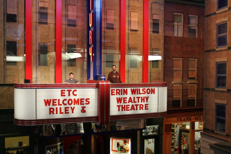 "Erin and Riley Wilson greeted by a marquee welcome sign at ETC, whose lobby is themed entirely on the ""Nighthawks"" painting."