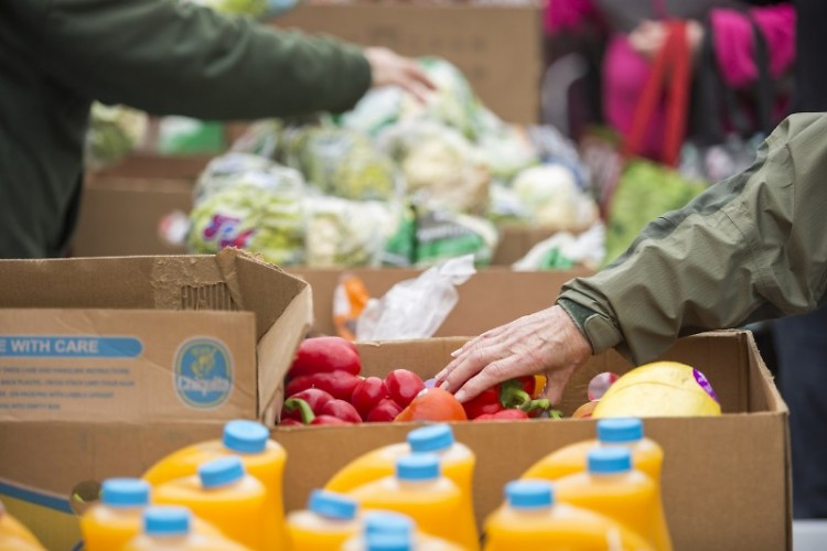 Clients receive food at one of Feeding America West Michigan's Mobile Food Pantries in April 2016.