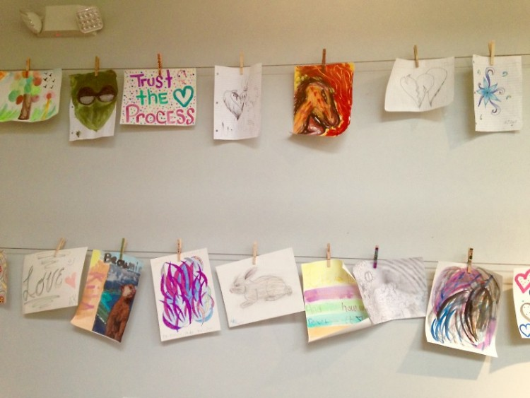 Hanging artwork at HQ crafted by youth, staff and volunteers.