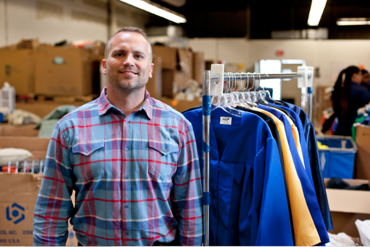 Seth Yon poses in the sorting warehouse at Goodwill on 29th Street