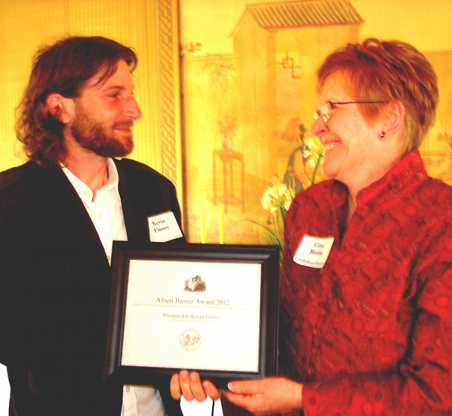 Gina Bivins, president of the Grand Rapids Historical Society, presented Kevin Finney the 2012 Baxter Award winner Thursday.