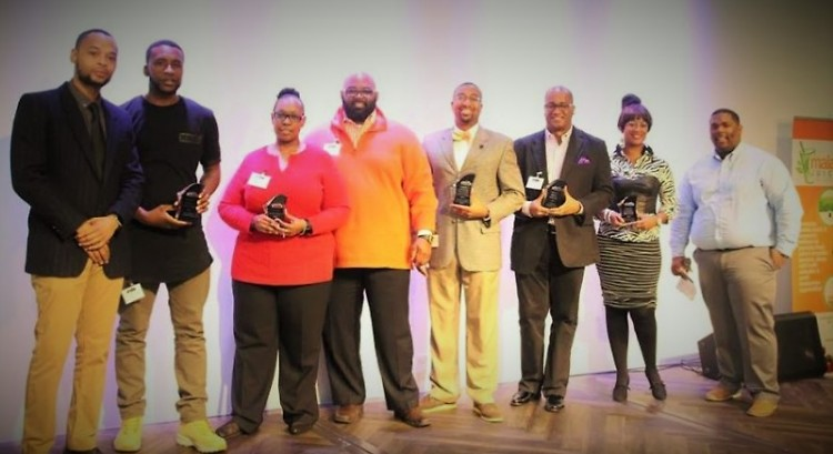 Jamiel Robinson, shown on far right with last year's GRABB award winners, is the organizer behind the #TheShift Summit.