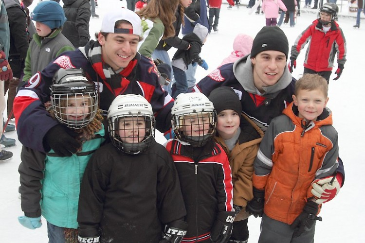Griffins players Francis Pare and Brendan Smith with young fans