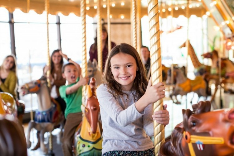 A museum attendee enjoys the carousel.