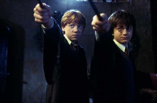 Rupert Grint (left) as Ron Weasley and Daniel Radcliffe as Harry Potter star in 'Harry Potter and the Chamber of Secrets.""