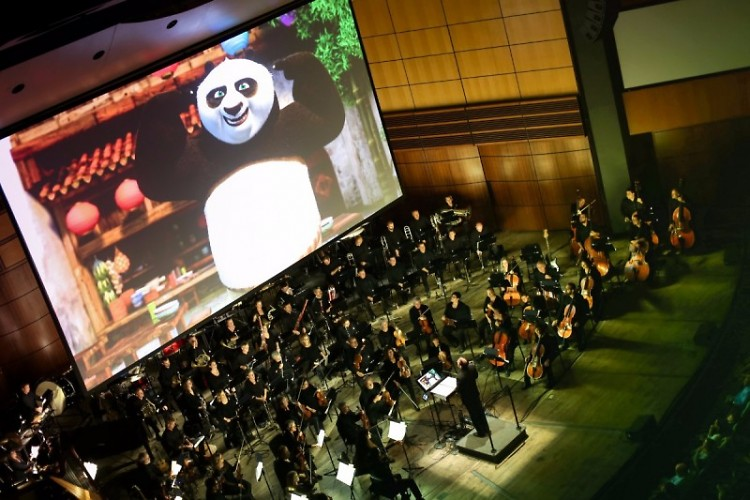 Guest conductor Justin Freer leads the Grand Rapids Pops in DreamWorks Animation in Concert in DeVos Performance Hall.