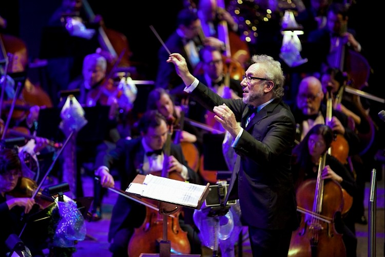 Principal Pops Conductor Bob Bernhardt leads the Grand Rapids Symphony in the Holiday Pops.