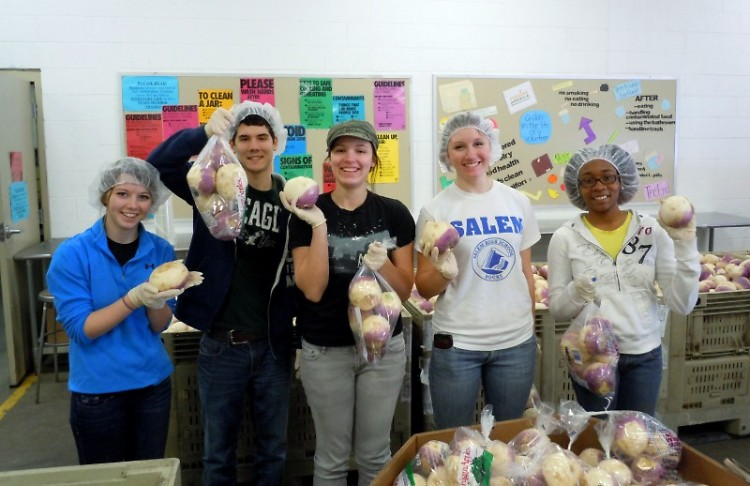 Students from Grand Valley State University bagged turnips for families in need.