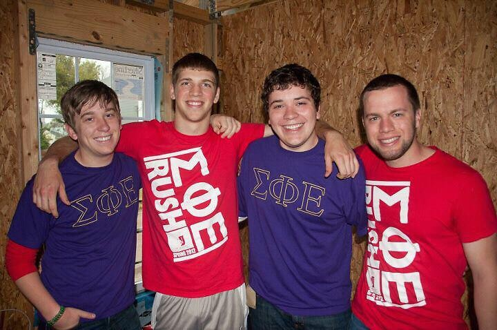 Kinch (second from left) with some of his brothers at a Habitat for Humanity build last year.