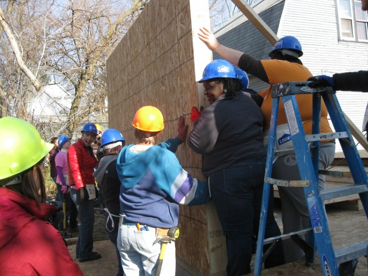 Volunteers from Habitat for Humanity of Kent County participate in wall-raising ceremony