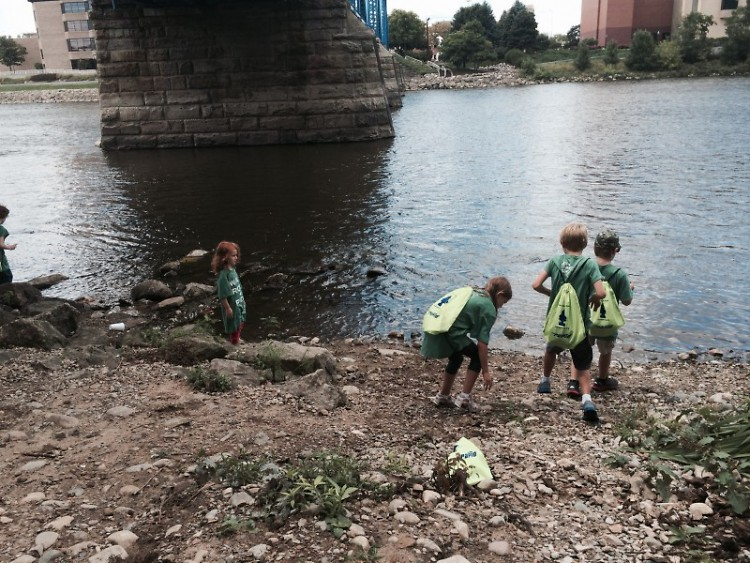 Day campers skip stones in the Grand River