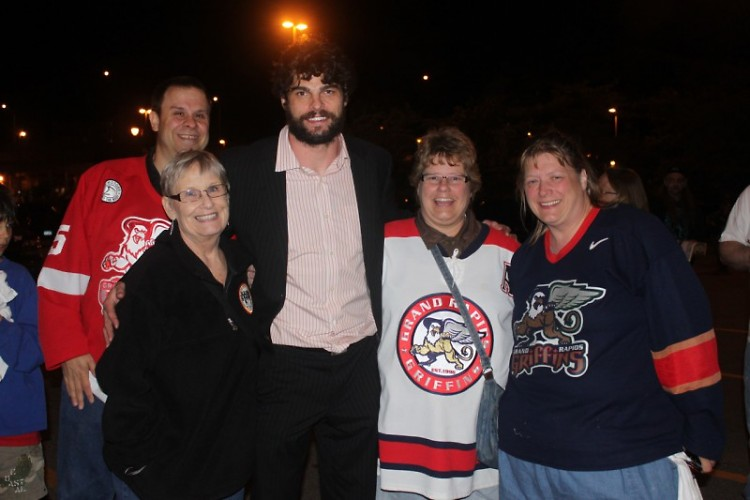 Griffins captain Jeff Hoggan with Griffins Booster Club memebers Ken Stauffer, Kit Domers, Jill DeWitt and Mary Theeuwes
