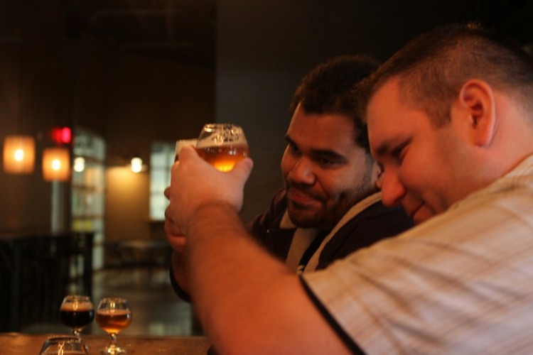 Ben Darcie (left) and Adam Reinke (right) clink glasses before starting the first drinks of the tour.