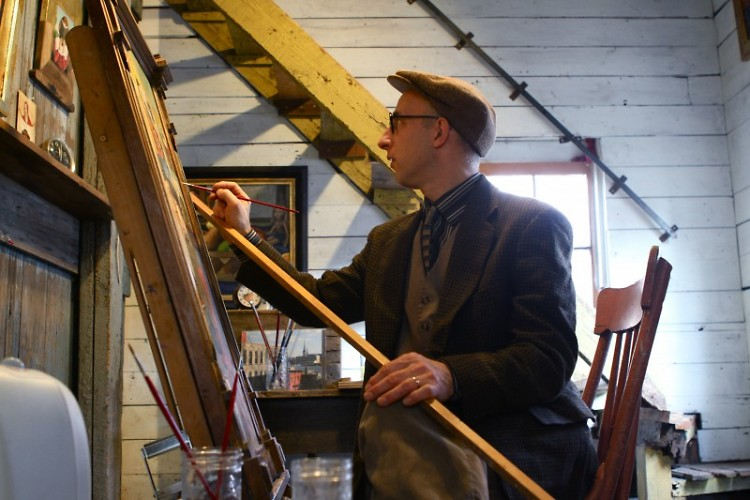 Rick Beerhorst paints in his studio