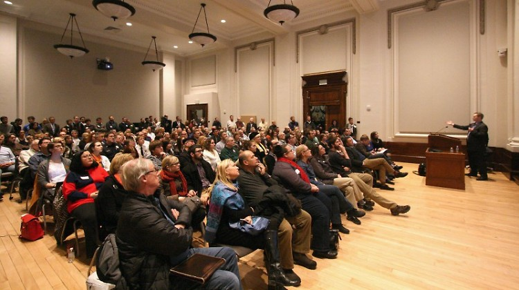 Downtown residents listen at a GR Forward forum held at the Federal Building earlier this year.