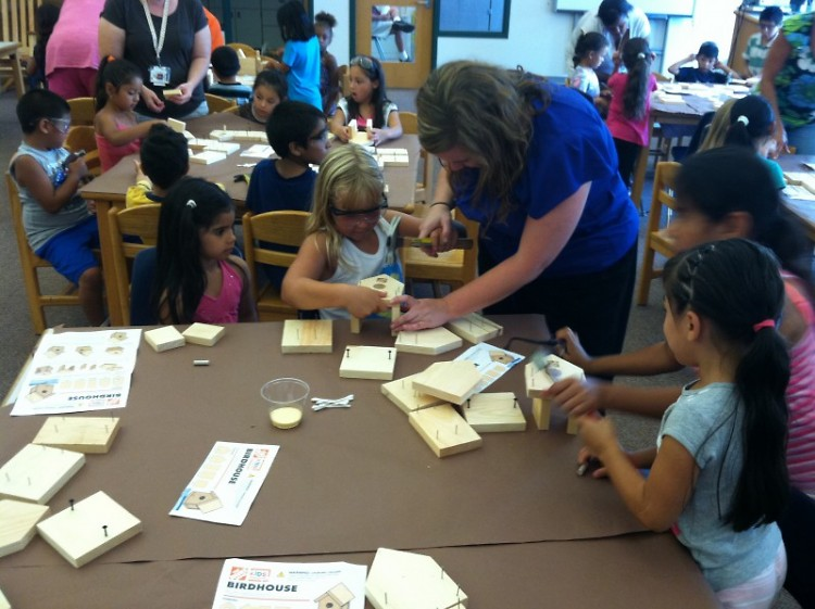 Bridget Knight helping students build birdhouses.