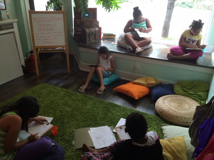 Young writers fill their notebooks with musings at the Grand Rapids Creative Youth Center