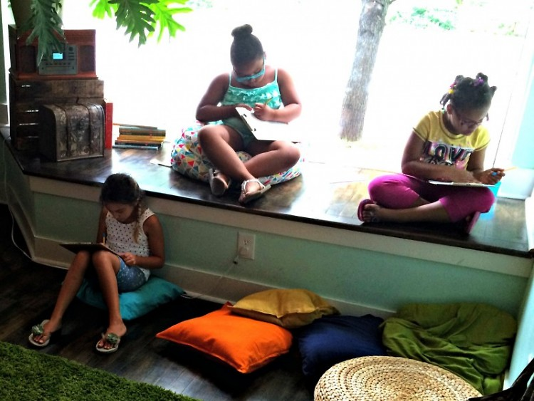 Children reading at the Creative Youth Center