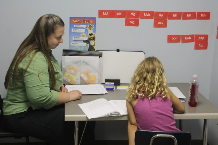 A teacher and student work one-on-one