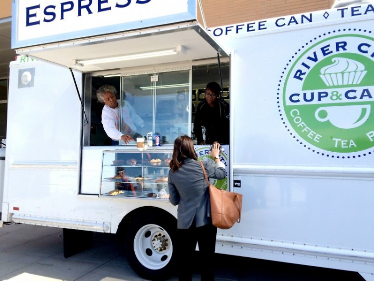 Lorin W. Tate serving customers from the River City Cup and Cake food truck